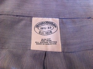 THis image shows the label on a Brooks Brothers shirt, showing made in Malaysia.