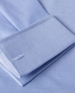 This image answers the question what is an oxford shirt - showing an image of shirt with an oxford weave