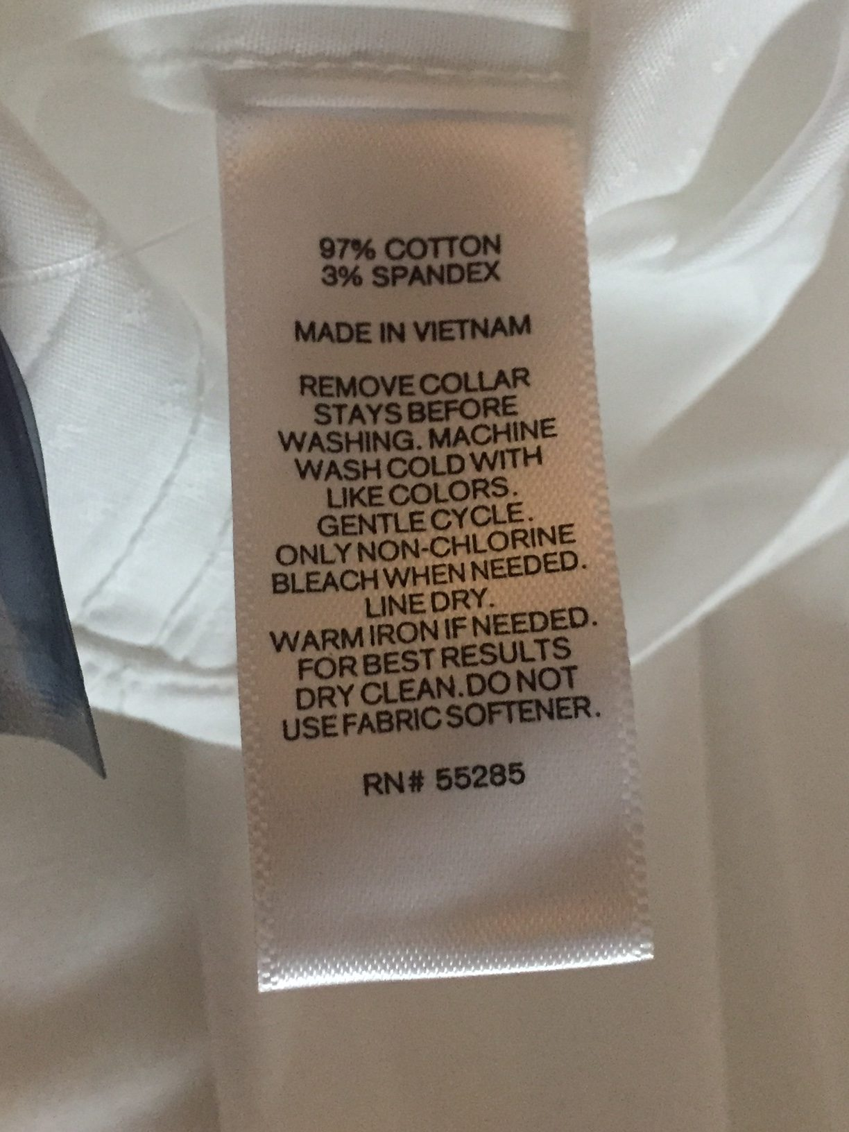 This image is part of the Express size chart and shows an Express tag, with the shirt made in Vietnam.